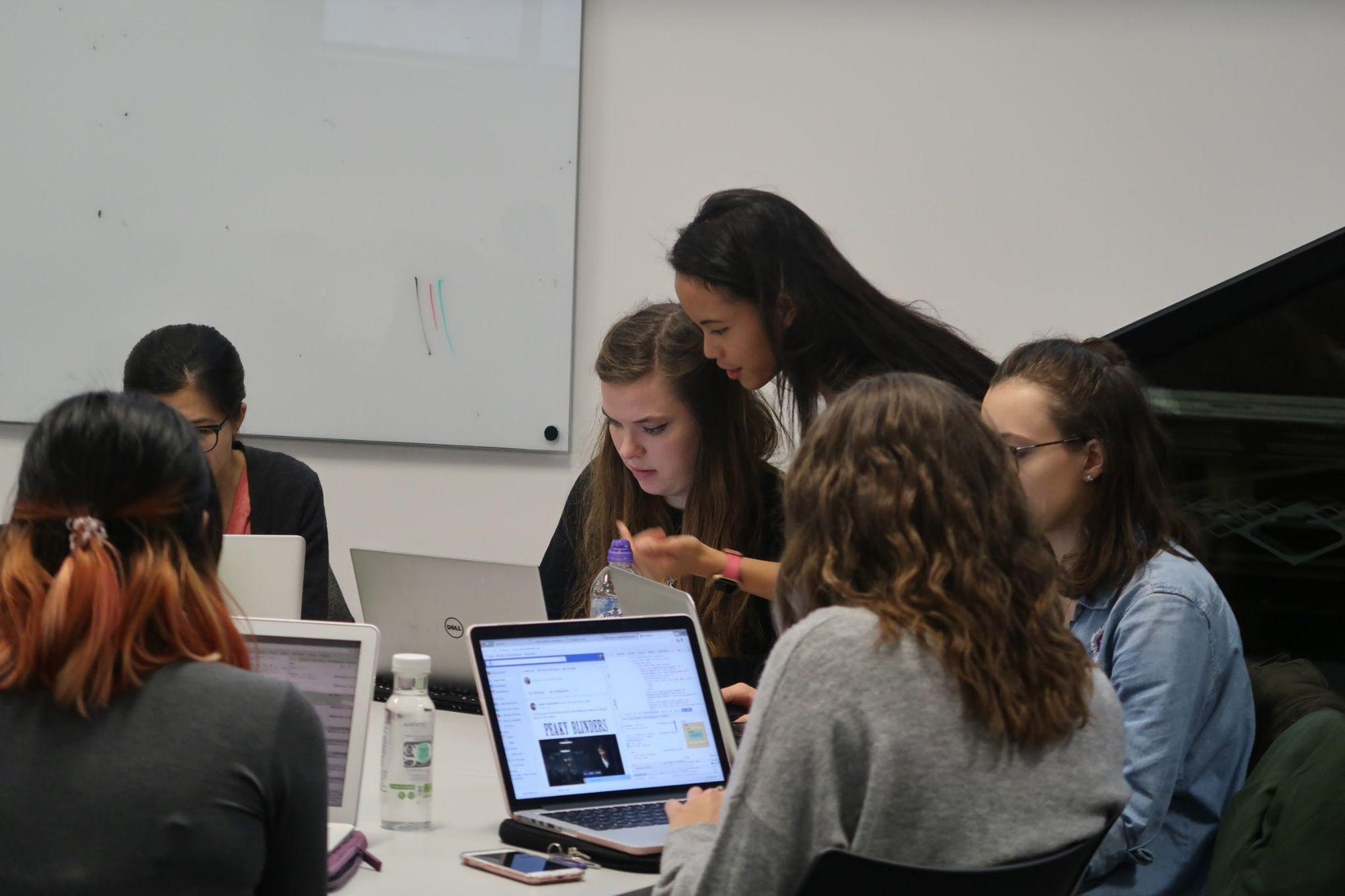 Pauline with women coding